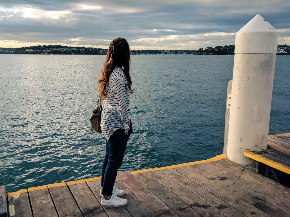 megumi waiting for the ferry at dusk